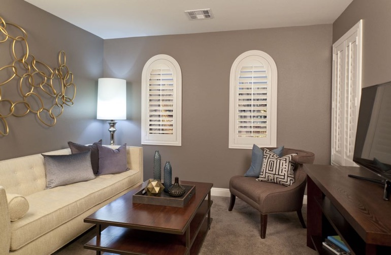 Atlanta family room with arch plantation shutters.