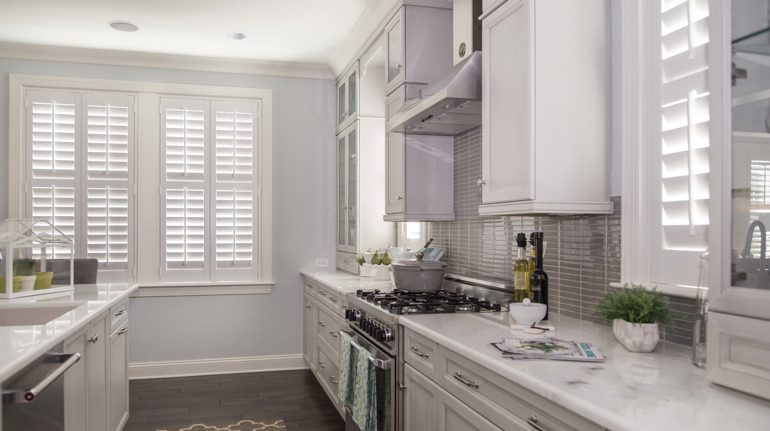 White shutters in Atlanta kitchen with white cabinets.
