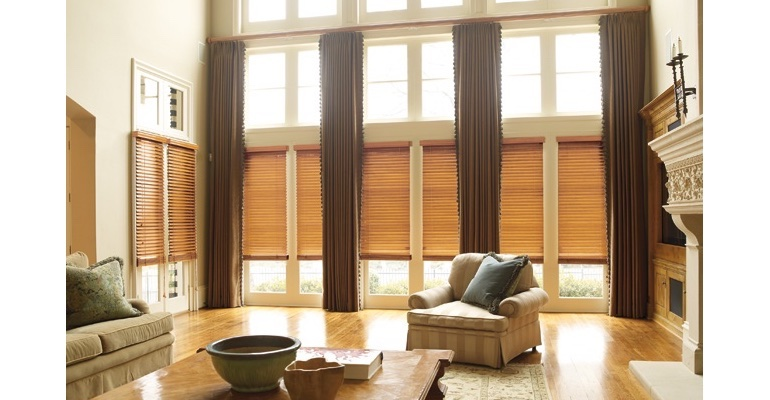 Atlanta great room with natural wood blinds and floor to ceiling draperies.
