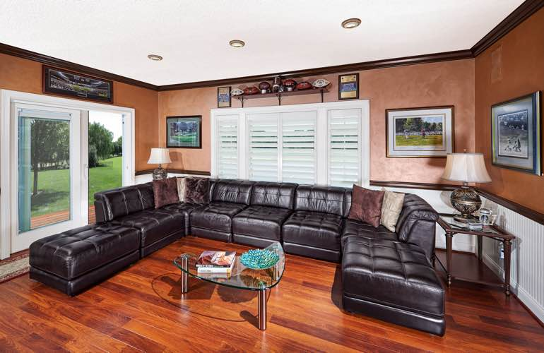 Atlanta basement with slider doors and plantation shutters.