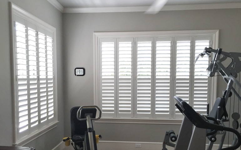 Atlanta fitness room with shuttered windows.