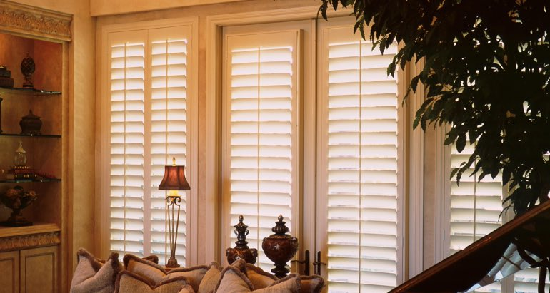 Plantation shutters on windows and door in Atlanta lounge
