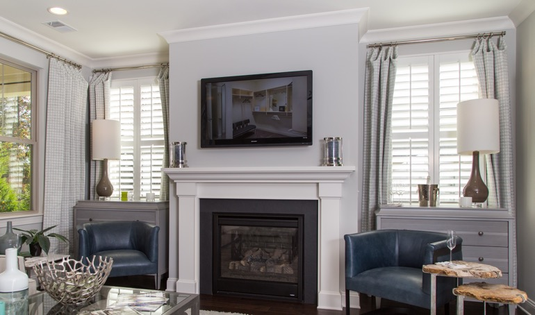 Atlanta fireplace with plantation shutters.
