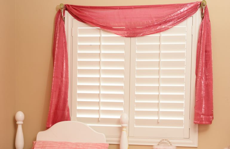 Child's bedroom with plantation shutters.