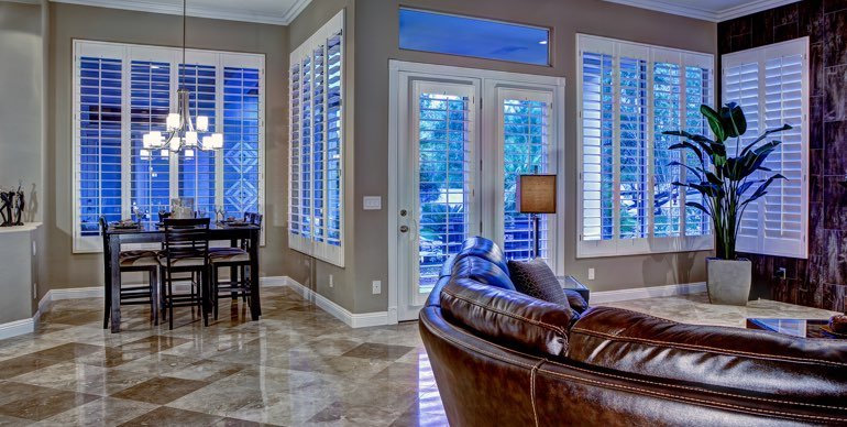 Atlanta great room with classic shutters and modern lighting.