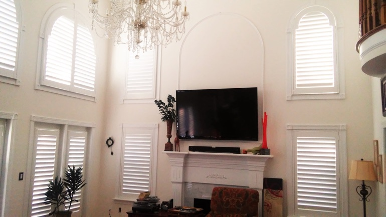 Atlanta great room with wall-mounted television and arched windows.