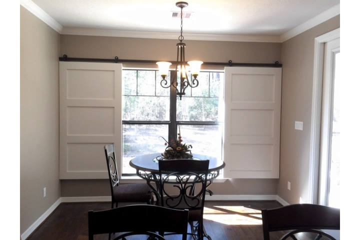 Atlanta dining room with classic barn door shutters.