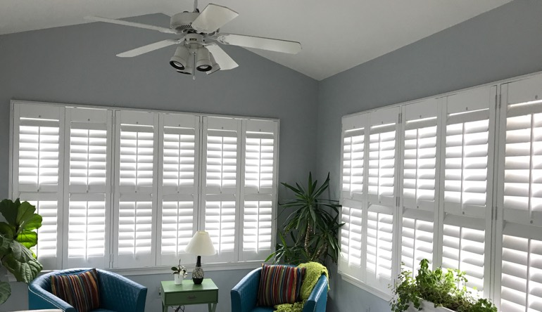 Atlanta living room with fan and shutters
