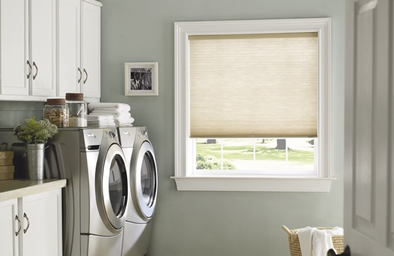 Atlanta laundry room with beige window shades.