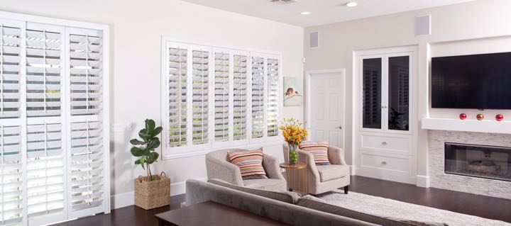 Atlanta living room in white with plantation shutters.