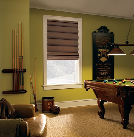 Roman shades in Atlanta pool room with green walls.