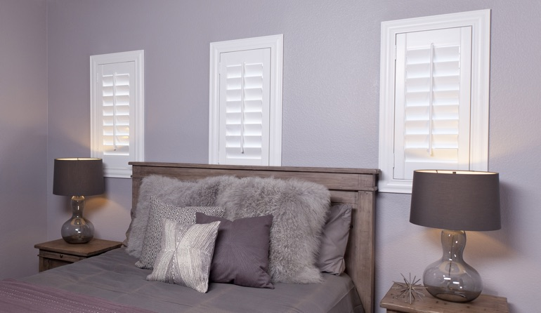 Studio plantation shutters in Atlanta bedroom windows.