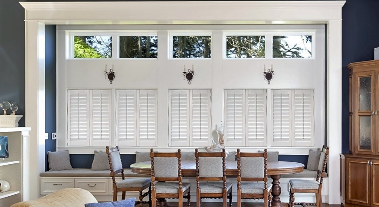 Closed white plantation shutters in Atlanta dining room.