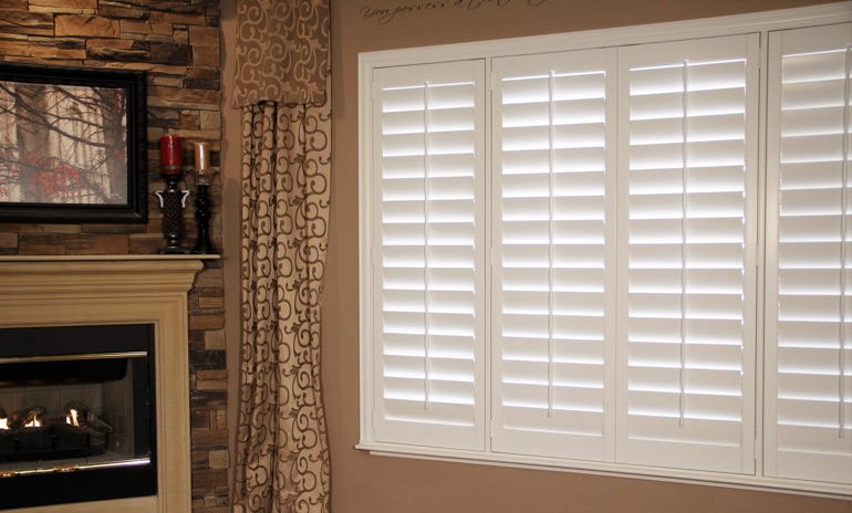 Atlanta Studio plantation shutters in family room.