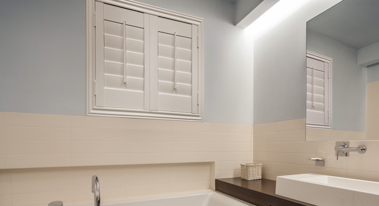 White waterproof shutters in Atlanta bathroom.
