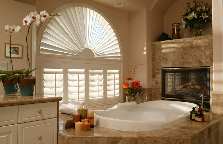 Semicircle shutters in a Atlanta bathroom.