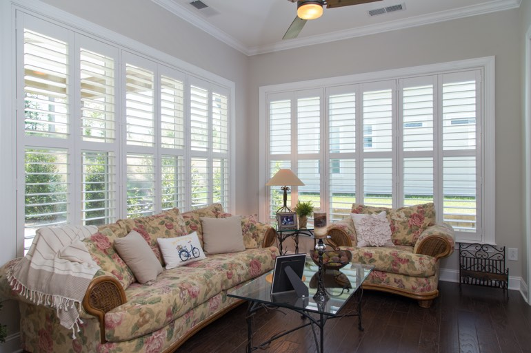 Airy sunroom with interior shutters in Atlanta.