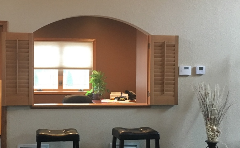 Shutters framing out a room's passthrough
