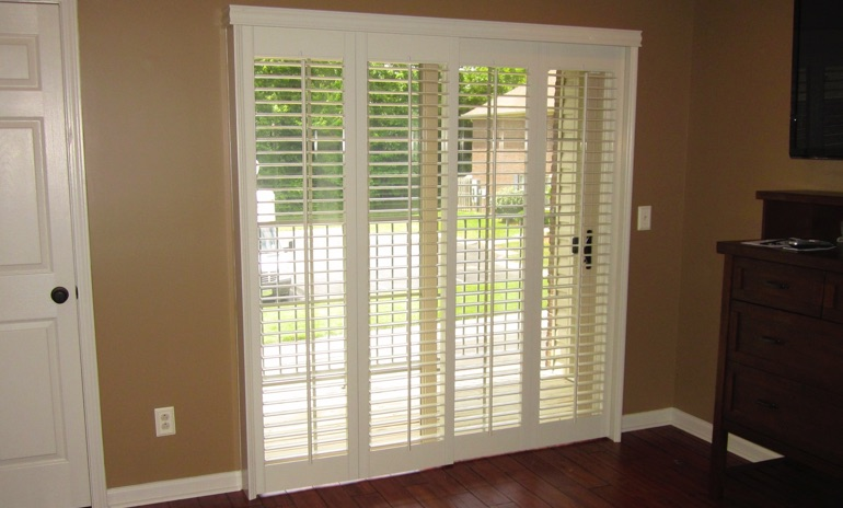 Atlanta sliding door bifold shutters in den