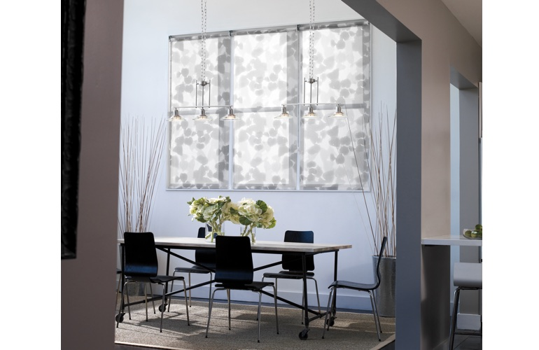 Contemporary room with patterned roller shades