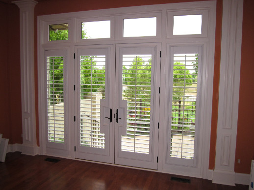Atlanta patio door with sidelight shutters