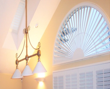 Atlanta arched eyebrow window with plantation shutter