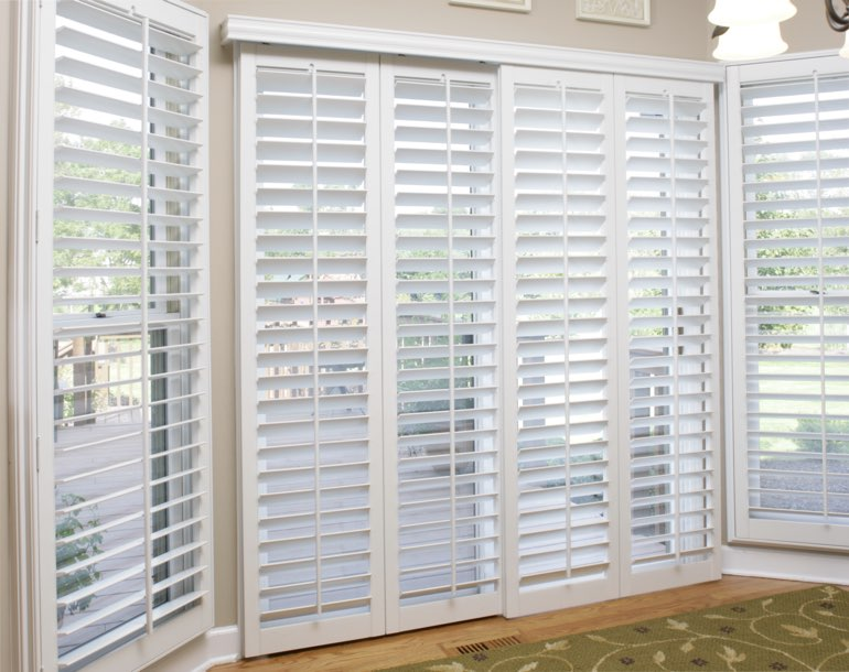Sliding glass door with white shutters Atlanta
