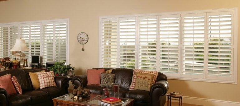 Wide window with plantation shutters in Atlanta living room